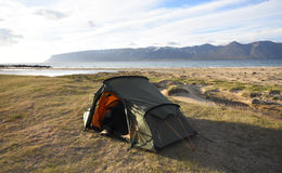 Wild camping in the Westfjords. Tent pitched on the beach in the Westfjords in Iceland Royalty Free Stock Image