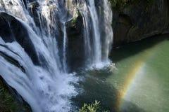 Wild cascade between stones in  forest landscape Stock Photo