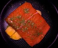 Wild Caught Salmon with Fresh Organic Chives and Cultured Organic Butter. Fresh wild caught salmon over some cultured organic butter with a sprinkle of organic Stock Images