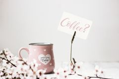 Wild cherry flowers, note holder with `Coffee?` text stock photo