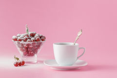 Wild cherry in a plate with a mug of coffee on a pink Stock Photos