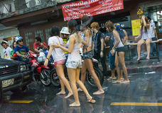 Wild chicks and transvestite blocking cars on street in Songkran Stock Photography
