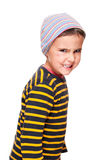 Wild child. Little rage bully with toothpick and black eye in striped sweater cap  isolated on white Royalty Free Stock Image