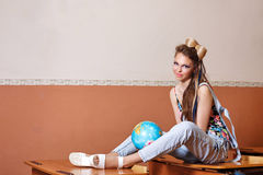 Wild Child in geography class with globe. Stock Images