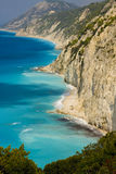 Wild coast of Lefkada. Glittering white rocks on the wild west coast of Greek island Lefkada are bathed by water of Ionian Sea royalty free stock image