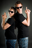 Wild couple with guns Stock Image