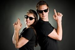 Wild couple with guns Stock Images