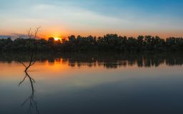 Wild Danube delta colorful sunset. Scenery during sunset from the wilderness of Danube Delta, blue sky, vegetation and wildlife, raw nature stock photography