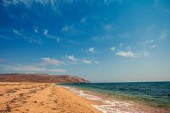 Wild deserted beach Stock Images