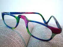 Wild Dictionary. A pair of wild colored reading glasses on a page of a dictionary royalty free stock photography