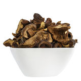 Wild and dried mushrooms placed in a white dish Stock Photos