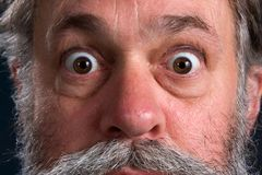 Wild Eyed Man. With his eyes popped open Stock Image
