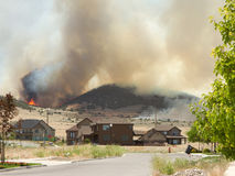 Wild fire or forrest fire endangers neighborhood royalty free stock photography