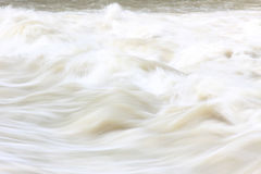 Wild floodwater, light brown stock photography