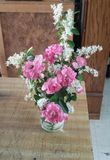 Wild flower boquet. Pink rise and white wild lilac stock photo