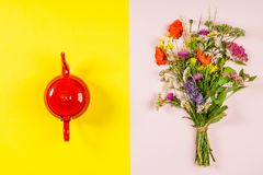 Wild flower bouquet and teapot Stock Images