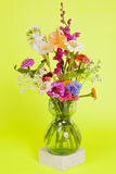 Wild Flower Bouquet. A vase of colorful wild flowers against a colorful solid background Stock Photo