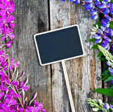 Wild flowers and a black board Stock Photo