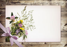 Wild flowers bouquet on white carton Royalty Free Stock Images