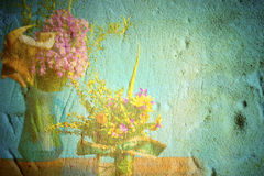 Wild flowers in grunge background Royalty Free Stock Photo