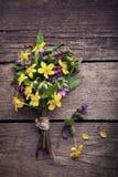 Wild flowers on old grunge wooden background.  Stock Photos