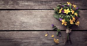 Wild flowers on old grunge wooden background.  stock images