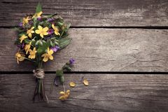 Wild flowers on old grunge wooden background.  Royalty Free Stock Image