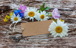 Wild Flowers with a vintage tag Stock Photo