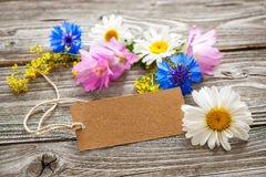 Wild Flowers with a vintage tag Stock Photography