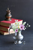 Wild flowers in a vintage vase Stock Photo