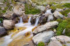 Wild flowing waters in the Alps, long exposure, close up Stock Photos