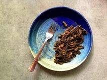 Wild, foraged morel mushrooms fried in butter on stoneware plate Royalty Free Stock Image