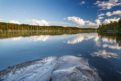 Wild forrest lake sky rock Stock Photos
