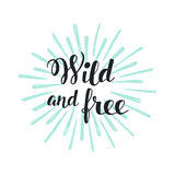 Wild and Free Modern Hand Lettering with Sun Rays Stock Photo