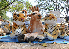 Wild friends. Wild animal toys against forest background Royalty Free Stock Images