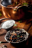 Wild Game Meat Rub Next to Pot on Wooden Table Stock Image