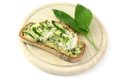 Wild garlic butter on slice of bread. breakfast. Isolated on white background Royalty Free Stock Image