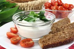 Wild garlic curd. A bowl of wild garlic curd with bread and tomato Royalty Free Stock Photo