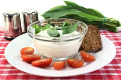 Wild garlic curd. A bowl of wild garlic curd with bread and tomato Stock Photos