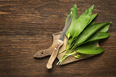 Wild garlic. Leafs on wooden background overhead shoot Stock Photos