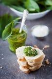 Wild garlic pesto. Glass of wild garlic pesto and fresh baguette Royalty Free Stock Image