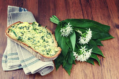 Wild garlic ramson in springtime. Bunch of wild garlic ramson and bread slice with ramson butter Royalty Free Stock Photos