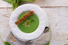 Wild garlic soup with Parmesan Royalty Free Stock Image