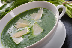 Wild garlic soup with Parmesan Royalty Free Stock Photography