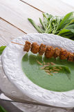 Wild garlic soup with Parmesan Royalty Free Stock Photo