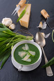 Wild garlic soup with Parmesan Royalty Free Stock Images