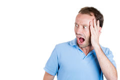 Wild, goofy, crazy, funny, shocked man's face looking to side Royalty Free Stock Photography