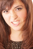 Wild grin. Young brunette woman in wild grin closeup photo Stock Photography