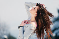 Wild Hair. Profile of a young woman leaning back with wind in her hair Royalty Free Stock Photos