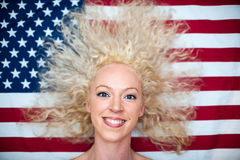 Wild hair woman on American flag Royalty Free Stock Photos